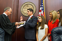 TALLAHASSEE, FLA. 11/18/14-ORGSESS111814CH-House Speaker Steve Crisafulli, R-Merritt Island, is joined by his family as he takes the oath of office during the Organizational Session of the legislature, Nov. 18, 2014 at the Capitol in Tallahassee.<br /> <br /> COLIN HACKLEY PHOTO