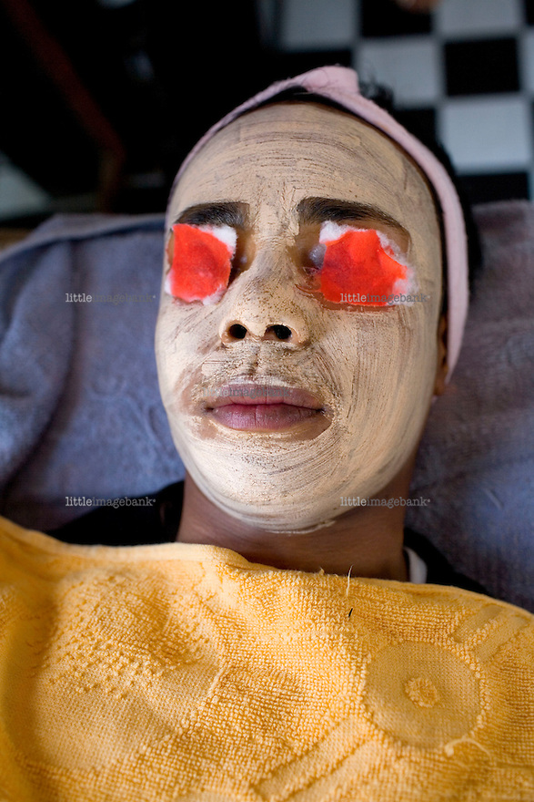 Sophie gets a facial. The transgender society of Nepal is one of a conciderable large community. They  have been supressed by the public and abused by security forces for decades and denied public services such as schools etc. In 2001. Sunil Pant returned from Belarus after studies, and was shocked by the violence and supression against his fellow transgender friends. He later founded the Blue Diamond Society, an NGO working for the rights of homosexuals, lesbians and transgender people. Nepal. Kathmandu 16.04.2008. Photo: Christopher Olssøn