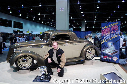 Troy Trepanier with Ross and Beth Meyers' 1936 Ford Coupe First Love at the 2007 Detroit Autorama