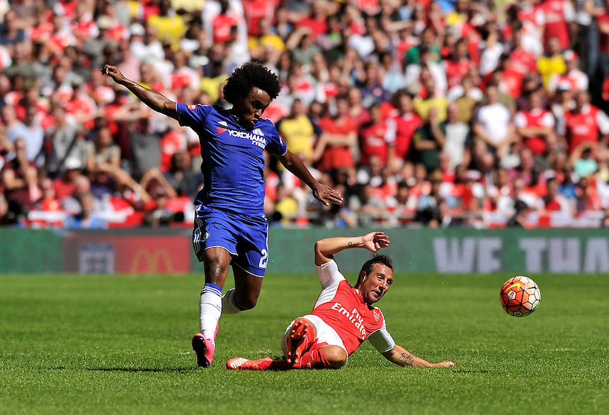 Chelsea's Willian battles for possession with Arsenal's Santi Cazorla<br /> <br /> Photographer Ashley Western/CameraSport<br /> <br /> Football - FA Community Shield - Arsenal v Chelsea - Sunday 2nd August 2015 - Wembley Stadium - London<br /> <br /> &copy; CameraSport - 43 Linden Ave. Countesthorpe. Leicester. England. LE8 5PG - Tel: +44 (0) 116 277 4147 - admin@camerasport.com - www.camerasport.com