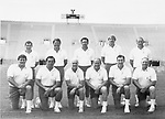 046<br /> <br /> Coaching Staff<br /> Standing Row: Chuck Stiggins, Jim Paronto, Ken Schmidt, Mike Holmgren, Mel Olson<br /> Kneeling Row: Lance Reynolds, Norm Chow, Dick Felt, LaVell Edwards, Roger French, Tom Ramage<br /> <br /> August 20, 1983<br /> <br /> Photography by: Mark Philbrick/BYU<br /> <br /> Copyright BYU PHOTO 2008<br /> All Rights Reserved<br /> 801-422-7322<br /> photo@byu.edu