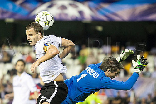 02.10.2012 Valencia, Spain. Goal keeper Mickael Landreau of LOSC Lille is fouled by Forward Roberto Soldado of Valencia CF on a high ball action during the Champions League Group G game between Valencia  and Lille from Mestalla, Valencia, Spain.