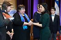 Montreal Mayor Valerie Plante greets members of Lise Payette's family during a memorial service in her honour at City Hall in Montreal, Saturday, October 20, 2018. THE CANADIAN PRESS/Graham Hughes