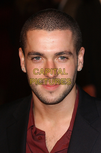 "SHAYNE WARD - X FACTOR.Premiere of ""King Kong"", Odeon Leicester Square, London..December 8th, 2005.Ref: BEL.headshot portrait facial hair stubble earrings piercings.www.capitalpictures.com.sales@capitalpictures.com.© Capital Pictures."