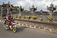 Bali, Indonesia.  Father and Daughter on Motorbike, no Helmets.