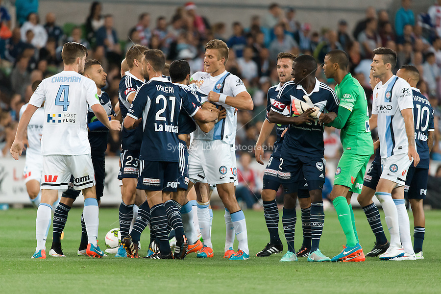 Players react after a foul in round 11 A-League match between Melbourne City and Melbourne Victory at AAMI Park in Melbourne, Australia during the 2014/2015 Australian A-League season. City def Victory 1-0