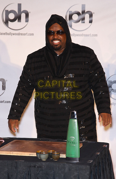 "Cee Lo Green (Thomas DeCarlo Callaway).CeeLo Green's official arrival for his new show ""CeeLo Green Is Loberace"" at Planet Hollywood Resort and Casino, Las Vegas, NV., USA..February 26th, 2013.half length black hooded top sequins sequined stripe jumpsuit sunglasses shades goatee facial hair .CAP/ADM/MJT.© MJT/AdMedia/Capital Pictures."
