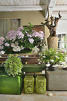 A garden room with potted plants and containers.