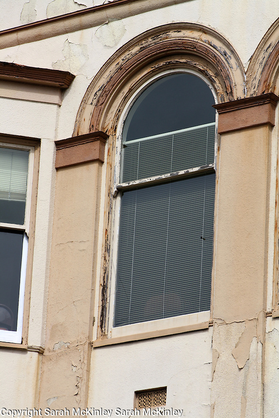 The arched window of a window on 3rd Street in Old Town Eureka in Humboldt County in Northern California.