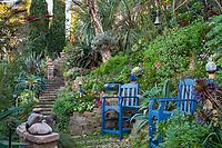 Blue chairs in garden overlook on hillside with stone path, Jim Bishop and Scott Borden garden