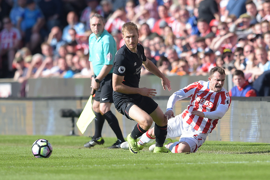 Stoke City's Xherdan Shaqiri is tackled by Liverpool's Ragnar Klavan<br /> <br /> Photographer Terry Donnelly/CameraSport<br /> <br /> The Premier League - Stoke City v Liverpool - Saturday 8th April 2017 - bet365 Stadium - Stoke-on-Trent<br /> <br /> World Copyright &copy; 2017 CameraSport. All rights reserved. 43 Linden Ave. Countesthorpe. Leicester. England. LE8 5PG - Tel: +44 (0) 116 277 4147 - admin@camerasport.com - www.camerasport.com