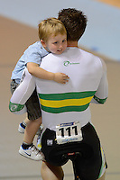 SHANE PERKINS of the Australian team celebrates with his son AIDAN after winning the Team Sprint on day 1 of the 2012 UCI Track Cycling World Championships at Hisense Arena in Melbourne, Australia. Photo Sydney Low. Copyright Sydney Low. All rights reserved. No reproduction permitted. Access via FlickrAPI not permitted.