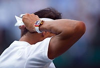 Rafael Nadal (4) of Spain fixes his headband during his victory against Donald Young of United States in their Men's Singles Second Round Match today - Nadal def Young 6-4, 6-2, 7-5<br /> <br /> Photographer Ashley Western/CameraSport<br /> <br /> Wimbledon Lawn Tennis Championships - Day 3 - Wednesday 5th July 2017 -  All England Lawn Tennis and Croquet Club - Wimbledon - London - England<br /> <br /> World Copyright &not;&copy; 2017 CameraSport. All rights reserved. 43 Linden Ave. Countesthorpe. Leicester. England. LE8 5PG - Tel: +44 (0) 116 277 4147 - admin@camerasport.com - www.camerasport.com