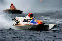 Jack Cotton drives his 280 class cabover hydro while being chased by a conventional style Lauterbach built 225 class hydroplane.