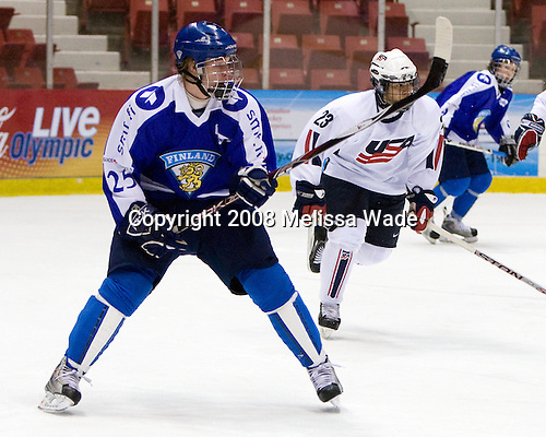 Sami Tervonen (Finland - 25), A.J. Treais (US - 23) - Team USA defeated Team Finland 3-2 to win the Four Nations Cup (Under-18 boys) on Saturday, November 9, 2008 in the 1980 Rink in Lake Placid, New York.