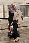 Two Palestinian Arab women wearing the traditional Muslim hajibs or head scarfs by the Damascus Gate in East Jerusalem.