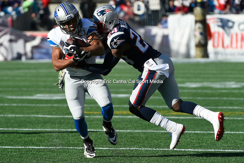 November 23, 2014 - Foxborough, Massachusetts, U.S.- Detroit Lions wide receiver Golden Tate (15) is tackled by New England Patriots cornerback Darrelle Revis (24) during the NFL game between the Detroit Lions and the New England Patriots held at Gillette Stadium in Foxborough Massachusetts. The Patriots defeated the Lions 34-9. Eric Canha/CSM