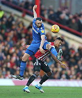 Bolton Wanderers' Marc Wilson and Brentford's Ollie Watkins<br /> <br /> Photographer Rob Newell/CameraSport<br /> <br /> The EFL Sky Bet Championship - Brentford v Bolton Wanderers - Saturday 22nd December 2018 - Griffin Park - Brentford<br /> <br /> World Copyright &copy; 2018 CameraSport. All rights reserved. 43 Linden Ave. Countesthorpe. Leicester. England. LE8 5PG - Tel: +44 (0) 116 277 4147 - admin@camerasport.com - www.camerasport.com