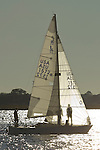 J24 j-24 sailboat uno sailing backlit sails boat sailboat charleston harbor south carolina