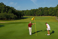 An older couple plays golf at Rolling Hills Country Club in Monroe, NC.