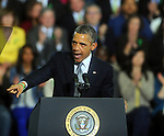 President Barack Obama points to the families of the Sandy Hook mass shooting as he demands action from the congress on his gun control legislation Monday, April 8, 2013, at the University of Hartford.  (Jim Michaud / Journal Inquirer).