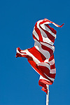 US flag flutters in the wind at north end of Hawthorne, Nev.