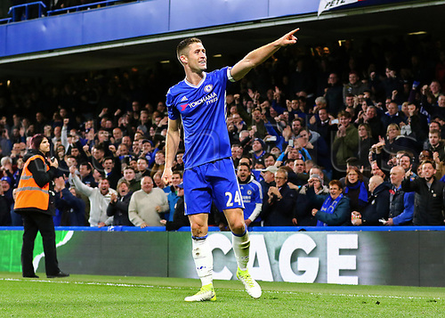 April 25th 2017, Stamford Bridge, Chelsea, London England; EPL Premier league football, Chelsea FC versus Southampton; Gary Cahill of Chelsea celebrates and points to family, after heading past Southampton Goalkeeper Fraser Forster in the 46th minute to make it 2-1 Chelsea