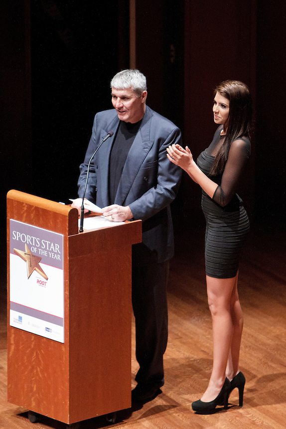 Super Bowl-winning quarterback Mark Rypien and his daughter Angela, quarterback for the Seattle Mist of the Lingerie Football League, present the 2011 Male Sports Star of the Year award at the 77th Annual Sports Star of the Year, presented by ROOT SPORTS, at Benaroya Hall in Seattle Wednesday, Jan. 27, 2012. The evening honors Northwest sports stars, carrying on an annual tradition started by Seattle Post-Intelligencer sports editor Royal Brougham in 1936. (Photography by Andy Rogers/Red Box Pictures)