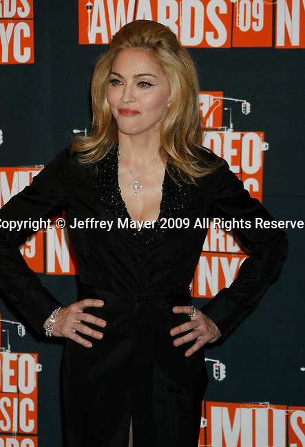NEW YORK, New York - September 13: Madonna poses in the press room at the 2009 MTV Video Music Awards at Radio City Music Hall on September 13, 2009 in New York City.