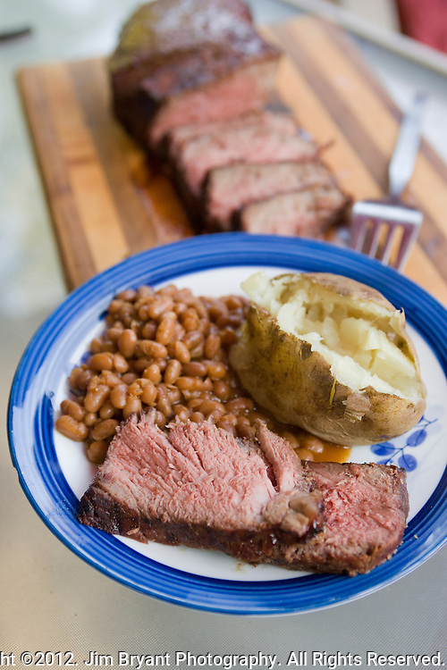 Grilled shoulder roast, baked beans and bake potato.  ©2012. Jim Bryant Photo. All Rights Reserved.