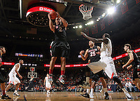 Dec. 22, 2010; Charlottesville, VA, USA; Seattle Redhawks forward Aaron Broussard (2) grabs a rebound in front of Virginia Cavaliers center Assane Sene (5) during the game at the John Paul Jones Arena. Seattle Redhawks won 59-53. Mandatory Credit: Andrew Shurtleff