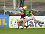 Arthur Rogers of St Joseph's Doora Barefield in action against Sean Phelan of Broadford during their Intermediate county final in Cusack Park. Photograph by John Kelly.