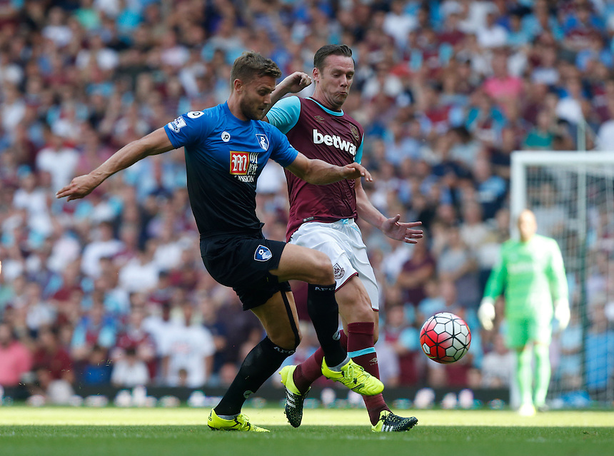 Bournemouth's Simon Francis despite the attentions of  West Ham United's Kevin Nolan<br /> <br /> <br /> Photographer Kieran Galvin/CameraSport<br /> <br /> Football - Barclays Premiership - West Ham United v Bournemouth - Saturday 22nd August 2015 - Boleyn Ground - London<br /> <br /> <br /> &copy; CameraSport - 43 Linden Ave. Countesthorpe. Leicester. England. LE8 5PG - Tel: +44 (0) 116 277 4147 - admin@camerasport.com - www.camerasport.com