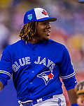 26 March 2018: Toronto Blue Jays third baseman Vladimir Guerrero Jr. returns to the dugout in the 8th inning of a pre-season exhibition game against the St. Louis Cardinals at Olympic Stadium in Montreal, Quebec, Canada. The Cardinals defeated the Blue Jays 5-3 in the first of two MLB Grapefruit League games, in which Guerrero Jr. made his first appearance since childhood at the former home on the Montreal Expos. Mandatory Credit: Ed Wolfstein Photo *** RAW (NEF) Image File Available ***