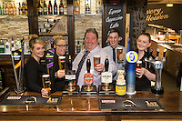 Pictured from left are  Samantha Adams, Rachael Weaver, owner Michael Perry, Ben Lovegrove, and Lois Hayes at The Fountain Bridge carvery restaurant and pub in Kirkby in Ashfield, Nottinghamshire.