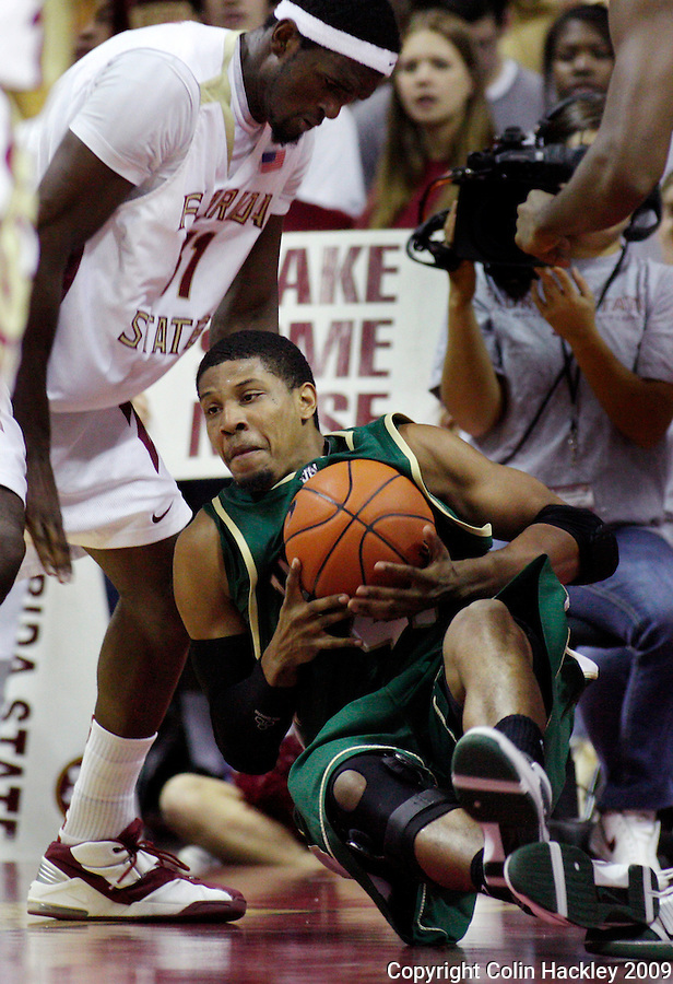 TALLAHASSEE, FL 11/16/09-FSU-JU BB09 CH12-Florida State's Chris Singleton watches as Jacksonville's Lehmon Colbert falls to the floor during first half action Monday at the Donald L. Tucker Center in Tallahassee...COLIN HACKLEY PHOTO