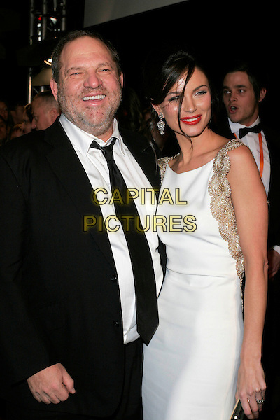 HARVEY WEINSTEIN & GEORGINA CHAPMAN.The Orange British Academy Film Awards in 2008 The Royal Opera House, Covent Garden, London, England. .February 10th, 2008 .BAFTA Arts half length black jacket suit white dress gold trim married husband wife.CAP/AH.©Adam Houghton/Capital Pictures