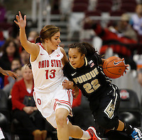 Ohio State Buckeyes guard Cait Craft (13) defends against Purdue Boilermakers guard KK Houser (22) during the first half of  a women's basketball game between the Ohio State Buckeyes and the Purdue Boilermakers at Value City Arena on January 2, 2014. ( Dispatch photo by Fred Squillante)