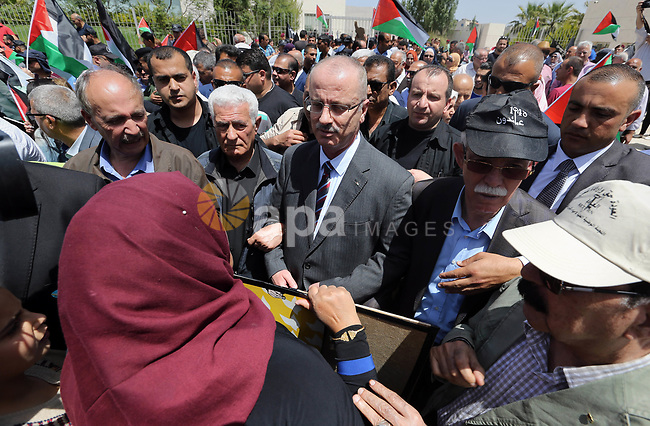 """Palestinian Prime Minister Rami Hamdallah takes part in a rally to mark the 69th anniversary of the """"Nakba"""" or """"catastrophe"""" in Arabic in reference to the establishment in 1948 of the state of Israel, in the West Bank city of Ramallah on May 15, 2017. Nakba"""" means in Arabic """"catastrophe"""" in reference to the birth of the state of Israel 69-years-ago in British-mandate Palestine, which led to the displacement of hundreds of thousands of Palestinians who either fled or were driven out of their homes during the 1948 war over Israel's creation. The key symbolises the homes left by Palestinians in 1948. Photo by Prime Minister Office"""