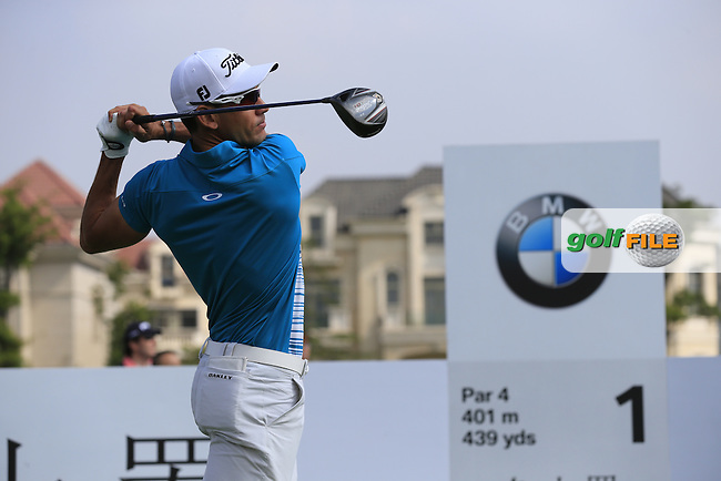 Rafael Cabrera-Bello (ESP) tees off the 1st tee to start his match during Saturday's Round 3 of the 2013 BMW Masters presented by SRE Group held at Lake Malaren Golf Club, Shanghai, China. 26th October 2013.<br /> Picture: Eoin Clarke/www.golffile.ie