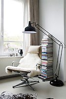 An original 1970s Eames chair is matched with a contemporary floor light in a corner of the living room