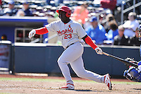 Jermaine Curtis #23 of the Memphis Redbirds swings against the Omaha Storm Chasers at a pitch at Werner Park on April 4, 2014 in Omaha, Nebraska. The Storm Chasers beat the Redbirds 20-3.   (Dennis Hubbard/Four Seam Images)
