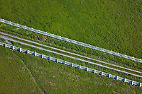 aerial above white picket fence Sonoma county, California in spring