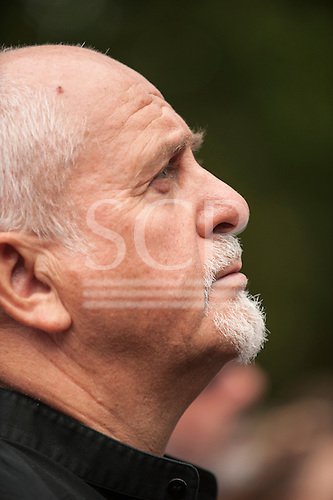 Musician peter Gabriel looks up at the speakers during the Climate Change demonstration, London, 21st September 2014. © Sue Cunningham
