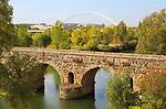 Modern bridge behind Puente Romano, Roman bridge crossing, Rio Guadiana River, Merida, Extremadura, Spain