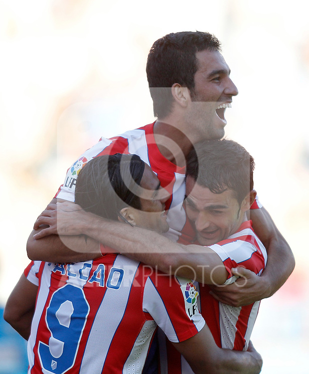 Atletico de Madrid's Radamel Falcao celebrates with Adrian Lopez and Arda Turan during La Liga Match. September 18, 2011. (ALTERPHOTOS/Alvaro Hernandez)