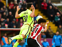 Lincoln City's Lee Angol vies for possession with York City's Hamza Bencherif<br /> <br /> Photographer Andrew Vaughan/CameraSport<br /> <br /> Buildbase FA Trophy Semi Final Second Leg - Lincoln City v York City - Saturday 18th March 2017 - Sincil Bank - Lincoln<br />  <br /> World Copyright &copy; 2017 CameraSport. All rights reserved. 43 Linden Ave. Countesthorpe. Leicester. England. LE8 5PG - Tel: +44 (0) 116 277 4147 - admin@camerasport.com - www.camerasport.com