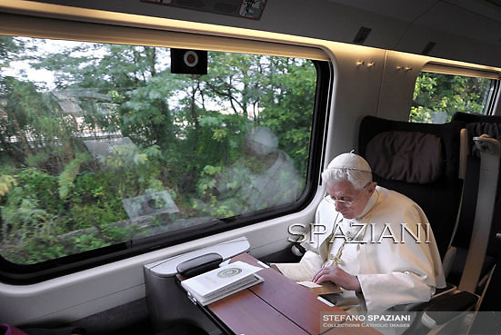 "Pope Benedict XVI reading in the train on his way to Assisi to attend the interreligious talks on October 27, 2011. Pope Benedict XVI will lead during the day the 25th Interreligious talks, a ""journey of reflection, dialogue and prayer for peace and justice in the world"" held in St. Francis of Assisi's birthplace,  October 27, 2011 in Assisi.Italy"