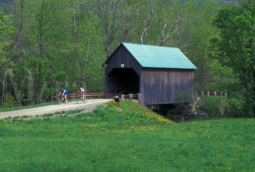 covered bridge, Vermont, VT, People biking over the Bowers or Brownsville Covered Bridge in West Windsor in the spring.