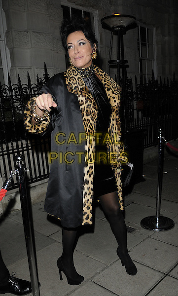 NANCY DELL'OLIO.The Tateossian 20th Anniversary celebration party, Christie's, London, England..November 22nd, 2010.full length black dress jacket coat leopard print trim hand arm.CAP/CAN.©Can Nguyen/Capital Pictures.
